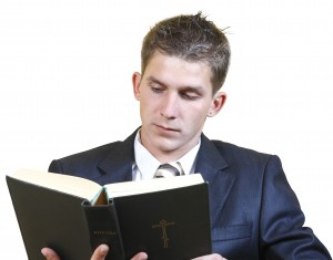 Young man in a suit Bible study